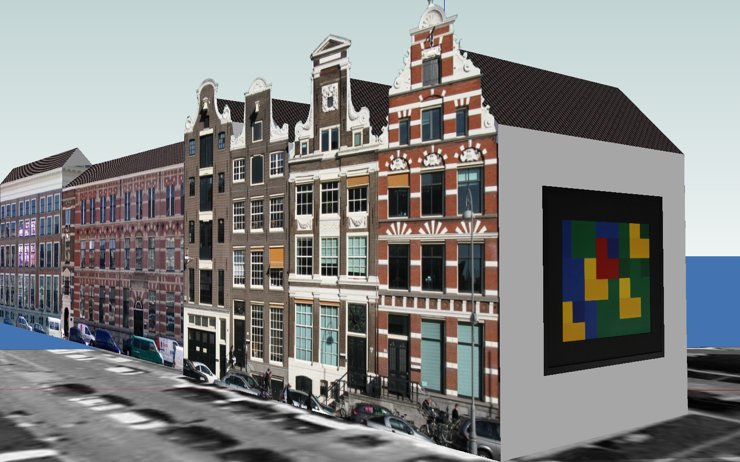 Amsterdam canal building with art work